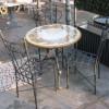 Completo tavolo da giardino, terrazzo in ferro forgiato e pietra lavica. ALTAMURA