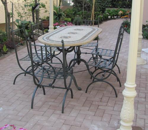 Realizzazione di arredi per giardino riccionese fonderia for Sedie da esterno in ferro battuto